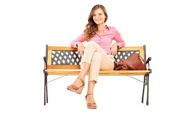 Beautiful brunette woman sitting on a bench