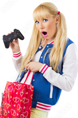 Surprised girl with game joystick