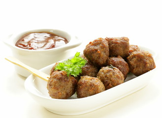 meatballs - traditional meat dish with sauce and herbs