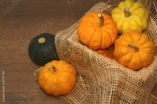 small pumpkin in crate