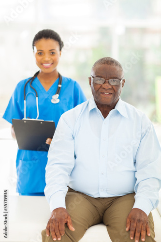 senior afro american patient in doctors office