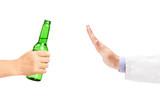 Medical doctor refusing a bottle of beer