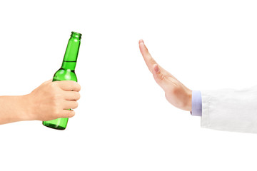 Medical doctor refusing a bottle of beer
