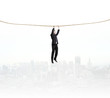 man climbing on a rope