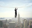 businessman climbing on a rope
