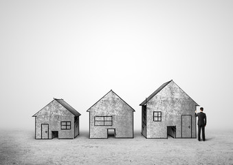 businessman drawing houses