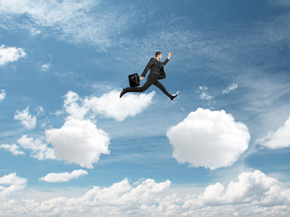 man jumping from cloud