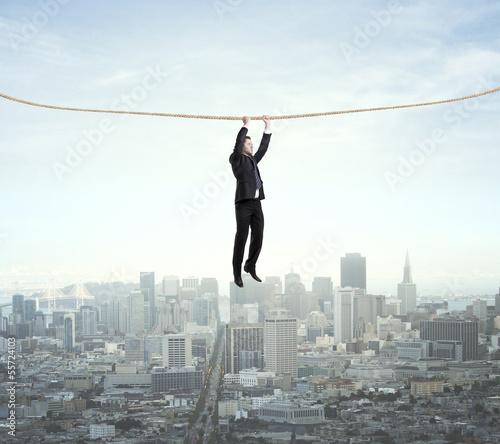 man climbing on a rope