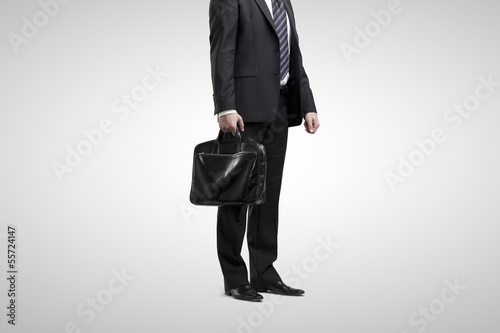 man standing with briefcase