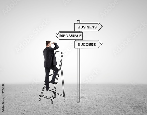 businessman standing at ladder