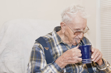 Elderly Man Drinking From Cup