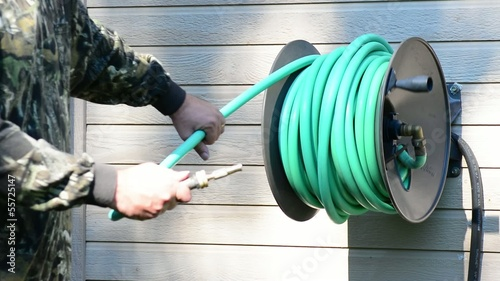 Hose being pulled out of a hose real