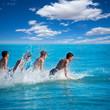 Boys surfers surfing running jumping on surfboards