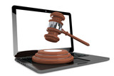 Cyber Law Concept. Moder Laptop with wooden gavel