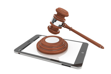Online Business Concept. Tablet PC with a gavel