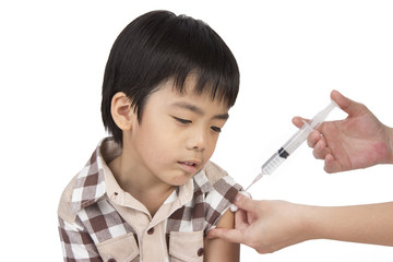 doctor give injection to boy