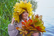 Cheerful woman with bouquet maple autumn leaves