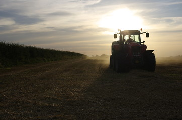 Baling Straw in the Evening