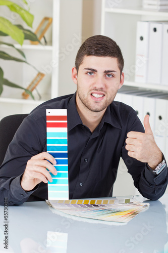 successful businessman showing  color palettes