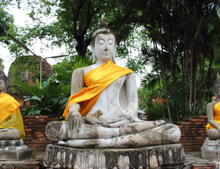 Ancient Buddha statues at Wat Yai Chai Mongkol in Ayutthaya, Tha