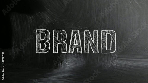 brand concept with white chalk on a blackboard