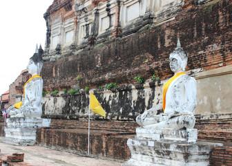 Ancient Buddha statues at Wat Yai Chai Mongkol in Ayutthaya, Tha
