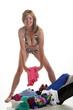 Woman in bikini packing holiday suitcase