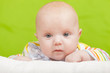Portrait of baby on a green background