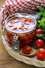 sun-dried tomatoes with herbs and olive oil in the pot