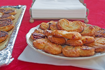 fan-shaped pastries on red