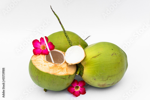 Green coconuts over white background
