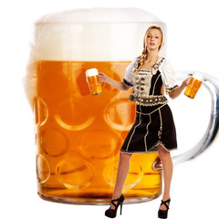 crazy oktoberfest style with tiroler girl serving beer