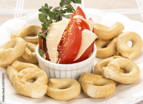Italian Appetizer or Taralli Crackers with Tomato and Parmigiano