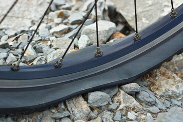 mountainbike flat tire on rocks
