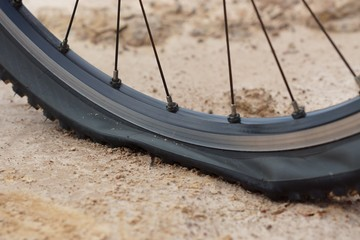 mountainbike flat tire on dirtland