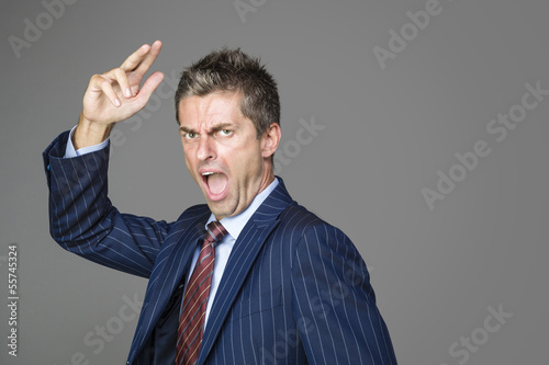 Very angry business boss shouting