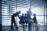 silhouettes of business people through the blinds - Fine Art prints