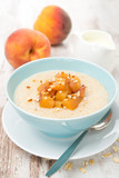 oatmeal with caramelized peaches in a bowl and yogurt