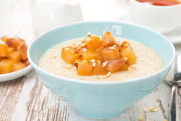 oatmeal with caramelized peaches for breakfast close-up