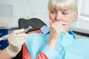 Woman at dental practice refusing treatment