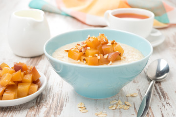 oatmeal with caramelized peaches, tea and yogurt