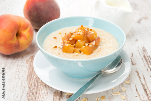 oatmeal with caramelized peaches in a bowl, yogurt for breakfast