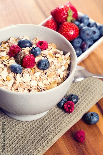 A bowl of muesli with fresh berries