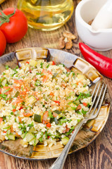 salad with bulgur, zucchini, tomatoes and parsley, vertical
