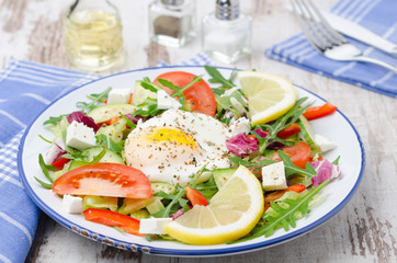 Vegetable salad with poached egg