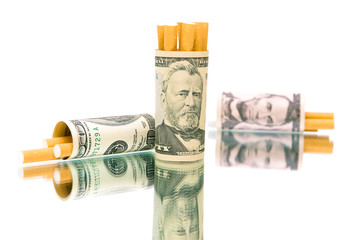 money (U.S. dollars) and a cigarette on a white background
