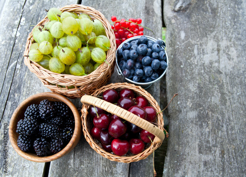 different berries on wooden table