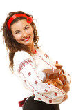 Beautiful ukrainian young woman in native costume holding earthe