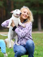 girl holding a dog