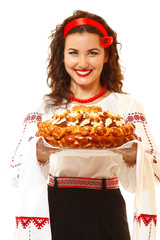 Beautiful ukrainian young hospitable woman in native costume by